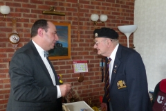 Ron Cornhill receiving the Legion d'Honneur from the French Consul Honoraire Jean-Claude Lafontaine.